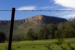 farmland near budawangs mountain range, new south wales. barbed-wire.